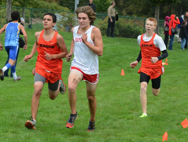 by: TIMES PHOTO: MATT SINGLEDECKER - Beaverton's Harrison Garrett nudged Westview's Morgan Nichols at the finish line to take 17th overall.