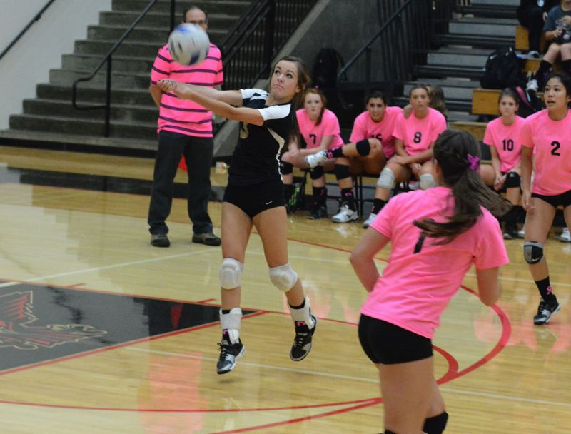 by: TIMES PHOTO: MATT SINGLEDECKER - Southridge freshman Natalie Greenberg digs a Beaverton kill attempt in the third game of the Skyhawks sweep of the Beavers on Thursday.