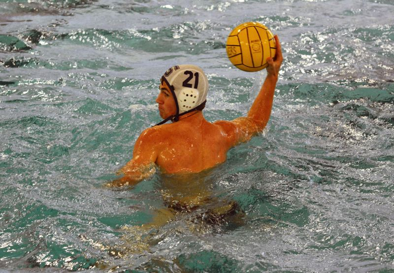 by: TIMES PHOTO: MATT SINGLEDECKER - Sunset junior Taylor Schmeck fires a shot towards the cage against Beaverton during the Apollos 13-3 win.