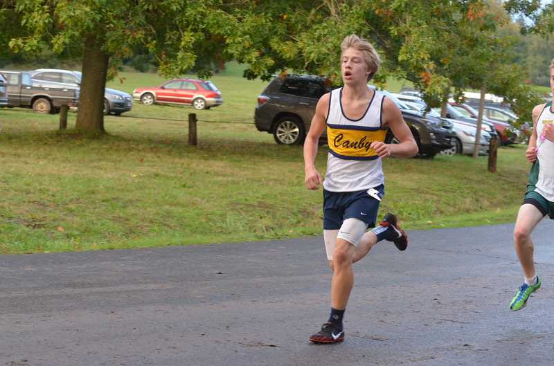 by: JEFF GOODMAN - Quinton Wiltshire runs Oct. 2 at Molalla River State Park. The standout sophomore had the third-fastest time for the Canby boys at the meet.
