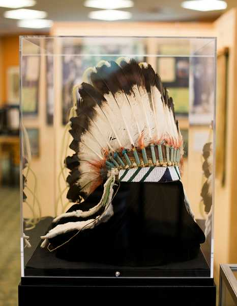 by: NEWS-TIMES PHOTO: CHASE ALLGOOD - This eagle-feather headdress was given to Oregon Gov. Vic Atiyeh by the Warm Springs Museum in honor of his outreach and commitment to Oregons tribes.