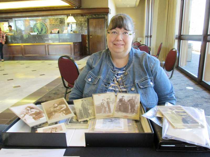 by: NEWS-TIMES PHOTO: ART HEERWAGEN - Karen Wallace Steely, the featured speaker at the Oct. 12 meeting of the Genealogical Society of Washington County, displays some of the pictures she will use to help teach the tests and techniques used in dating and identifying old family photos.