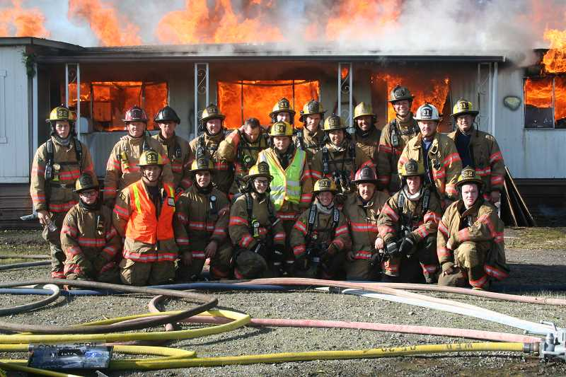 by: WOODBURN FIRE DISTRICT  - Volunteer and career firefighters received 'Live Fire' training Saturday at Wilson Construction in Woodburn.