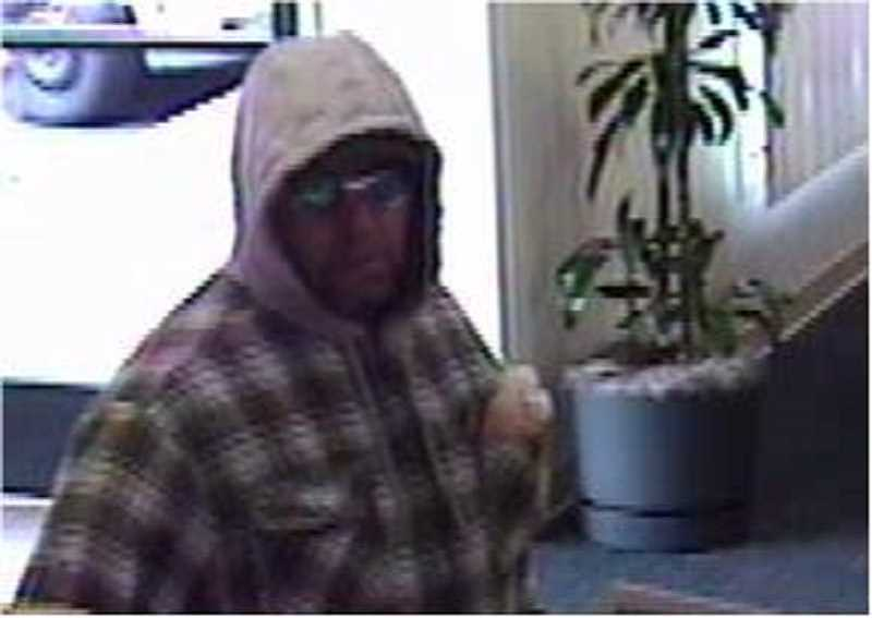 by: SUBMITTED PHOTO - The Tualatin Police Department released this surveillance image of the man believed to have robbed Bank of the West in Tualatin on the morning of Sept. 5.