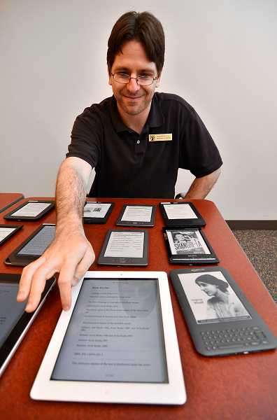 by: TIDINGS FILE PHOTO: VERN UYETAKE - Make an appointment with a librarian to get help with your e-reader or tablet.