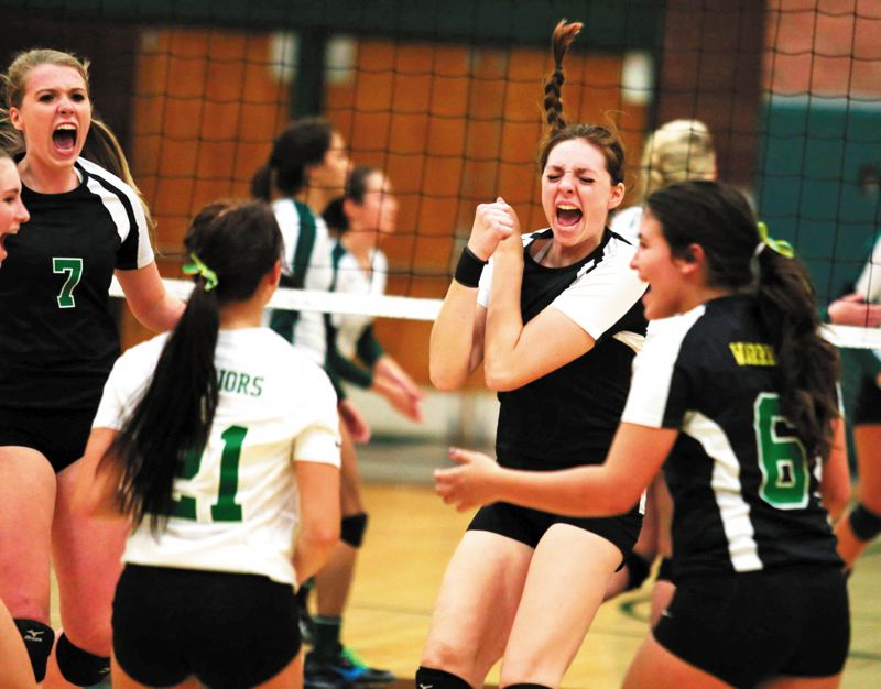 by: TRIBUNE PHOTO: JONATHAN HOUSE - Cleveland High volleyball players (from left) Natalie Lannigan, Courtney Paxton, Perry Williams and Lizzette Montes celebrate a point in their second 3-0 sweep of Wilson this season last week at Wilson.