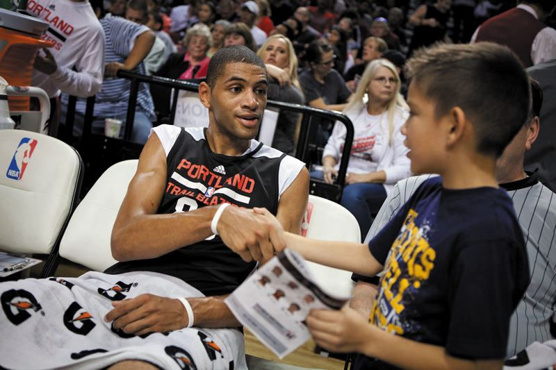 by: TRIBUNE PHOTO: ADAM WICKHAM - Nicolas Batum, talking to a fan at halftime of Sundays Fan Fest, returns to a Trail Blazers frontcourt that is expected to benefit from the addition of Robin Lopez and Thomas Robinson.
