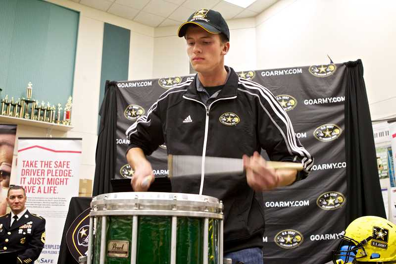 by: TIMES PHOTO: JAIME VALDEZ - Jay Reddicks, 17, is one of five snare drummers in the country selected for the marching band. Reddicks was officially welcome to the band at a ceremony hosted by the US Army at Tigard High on Tuesday.