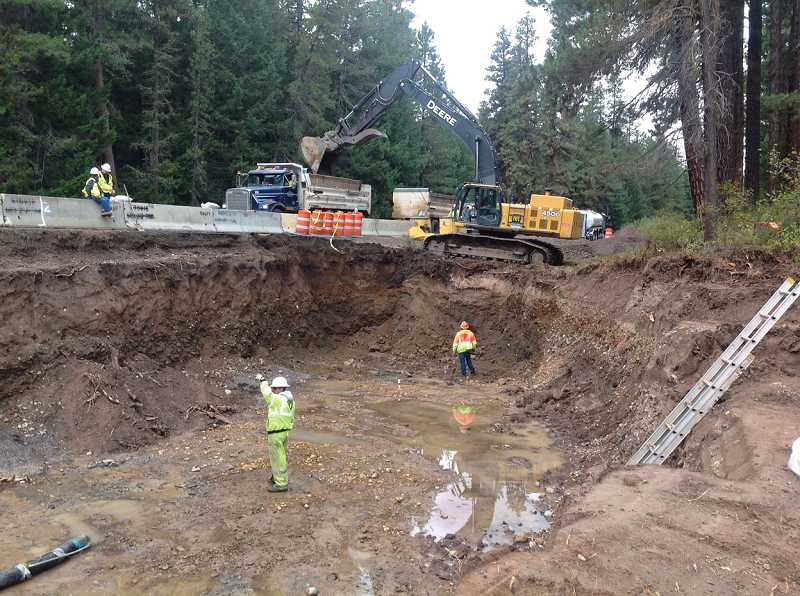 by: PETER MURPHY/ODOT - A hazardous materials cleanup crew has removed soil contaminated by a fuel spill adjacent to U.S. Highway 26, about 23 miles northwest of Warm Springs. Crews have excavated a 14-foot deep trench, extending at least 288 feet, at a width of 45 feet.