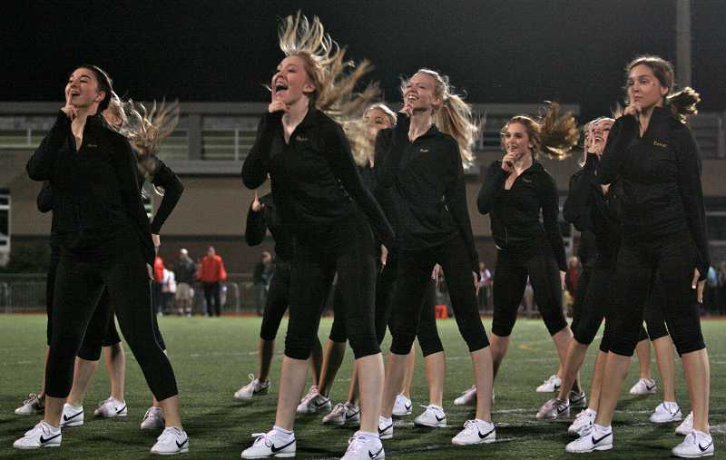 by: TIDINGS PHOTO: J. BRIAN MONIHAN - Members of WLHSs dance team, the Debutantes, perform at the homecoming game.