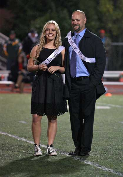 by: TIDINGS PHOTO: J. BRIAN MONIHAN - Freshman Princess Jenna Ittershagen is escorted by her father while freshman Prince Jonny Neville plays in the football game.