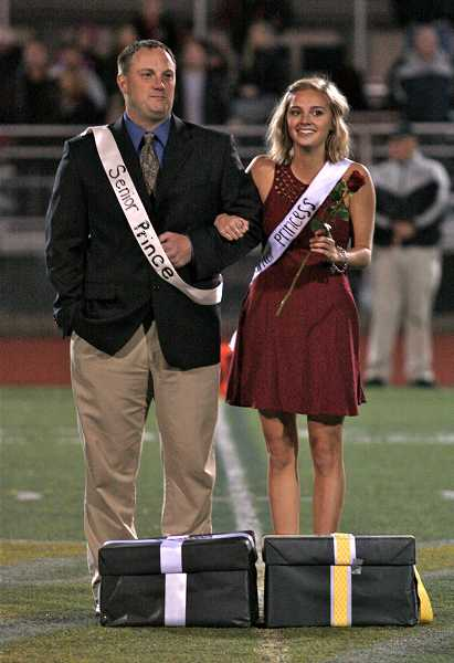by: TIDINGS PHOTO: J. BRIAN MONIHAN - Senior Princess Mackenzie Baker is escorted by her father, Travis Baker, while senior Prince Ellis Eaton plays in the football game.