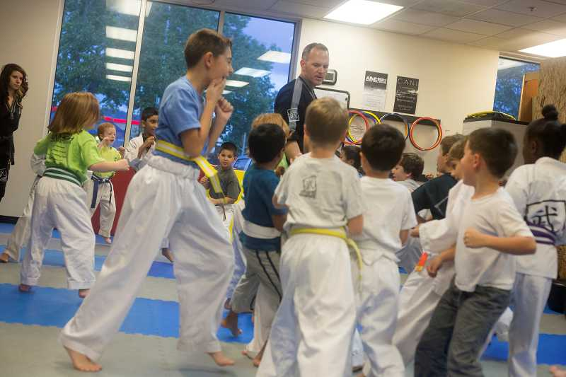by: TIMES PHOTO: JONATHAN HOUSE - Aim High instructor Randle Reeds leads the youngest class in basic martial arts footwork.