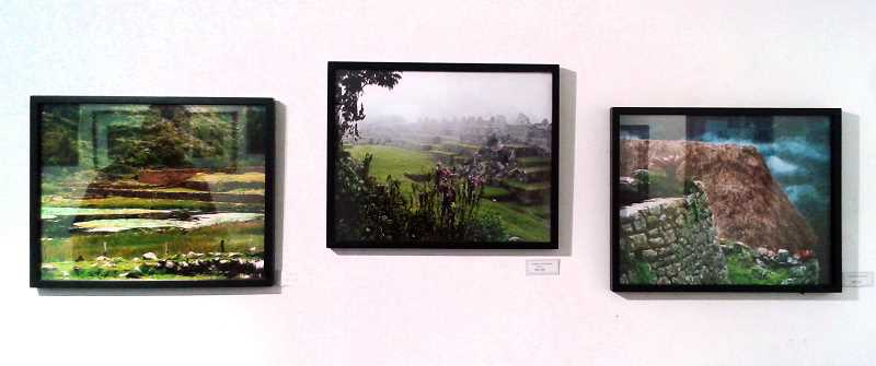 by: ESTACADA NEWS PHOTO: ISABEL GAUTSCHI - Several photographs from Holloway's world travels hang in the show.