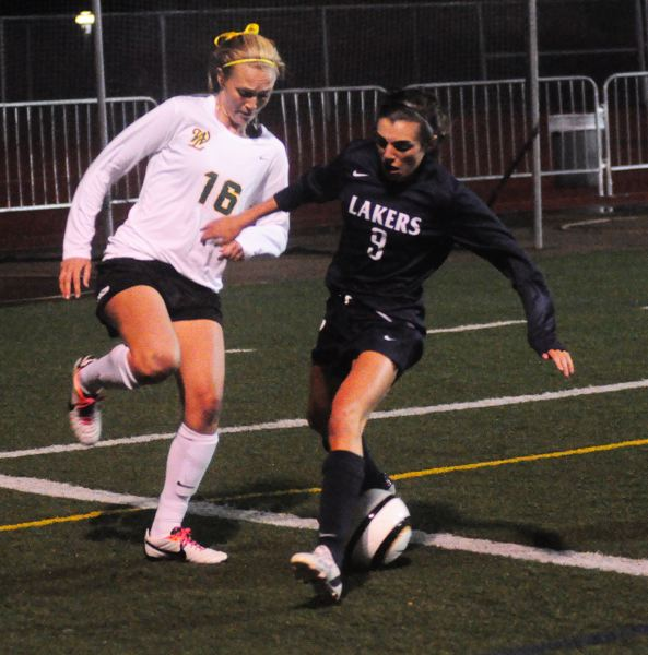 by: MATT SHERMAN - Katie Moller tries to win a ball near the endline during West Linn's 3-0 win over Lake Oswego on Tuesday. Moller had a pair of first-half goals in the game.