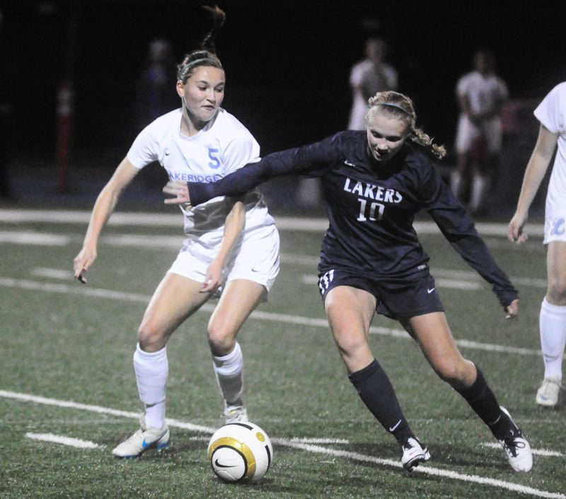 by: MATT SHERMAN - Lakeridge's Nicole Helm, left, and Lake Oswego's Emily Elott battle for a ball in last week's 1-1 draw.