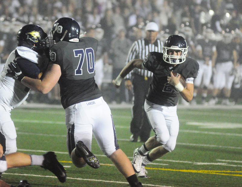 by: MATT SHERMAN - Lake Oswego's A.J. Van Leeuwen finds a seam en route to a seven-yard touchdown run, helping the Lakers to a 35-14 win over Canby last week.