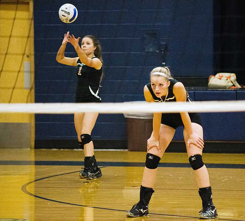 by: PHOTO BY LISA FIGUEROA/SMALL TOWN SPORTS NETWORK - Culver's Kaylee Aldrich lines up her serve while teammate Gabrielle Alley waits for action during the Bulldogs' 3-0 win against Kennedy on Thursday in Mount Angel. The Bulldogs are a perfect 12-0 in Tri-River Conference play.