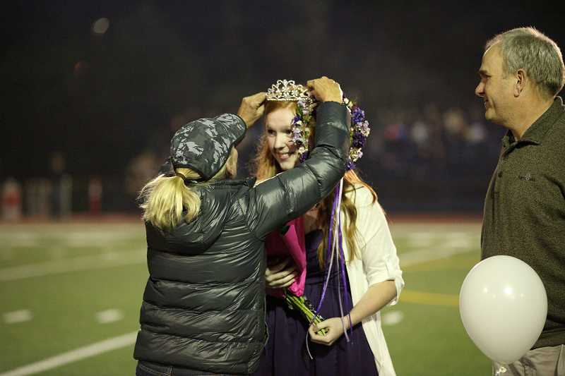 by: SUBMITTED PHOTO: MITCHELL BERNARDS - Lake Oswego High School teacher Diana Lavender crowns Haley Jensen, while Haley Jensens father, Kirk Jensen, stands at her side.