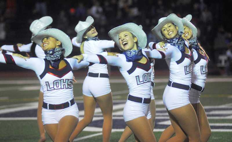 by: REVIEW PHOTO: MATTHEW SHERMAN - Dancers entertained at the LOHS homecoming game last week.