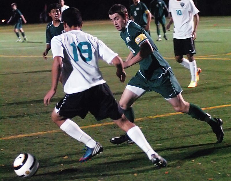 by: DAN BROOD - GETTING DEFENSIVE -- Tigard senior Sean McManamon (right) looks to get the ball from Century's Carlos Hernandez-Morfin in last week's game.