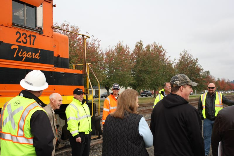by: SPOTLIGHT PHOTO: ROBIN JOHNSON - first responders as well as county commissioners, Scappoose city councilors and Scappoose Mayor Scott Burge gather for a hazardous material safety demo put on by Portland & Western Railroad.