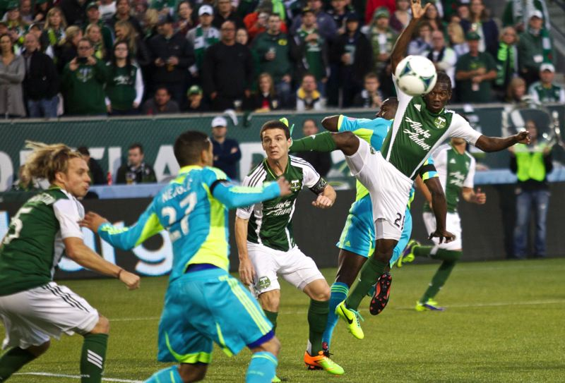 by: TRIBUNE PHOTO: JAIME VALDEZ - Portland Timbers midfielder Diego Chara heads the ball after a corner kick against the Seattle Sounders.