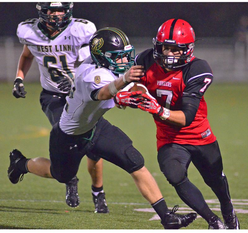by: VERN UYETAKE - Oregon City sophomore running back Conner Mitchell (7) carried much of the load in last weeks game with West Linn, rushing 40 times for 237 yards and three touchdowns in a 31-28 Pioneer victory.