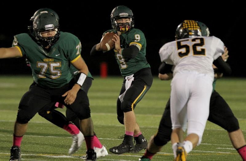 by: JON HOUSE - Putnam quarterback Josey Swain sets up to pass, as he gets good protection from Juan Hernandez (75) and another lineman in last Fridays game with St. Helens.