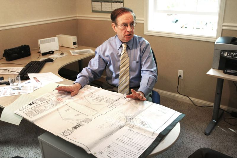 by: OUTLOOK FILE PHOTO: JIM CLARK - Jim Kight discusses the plans of his building.