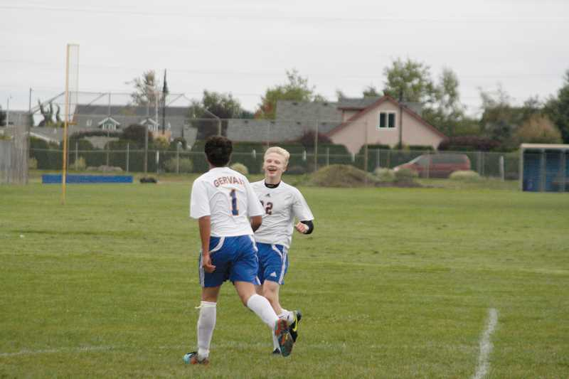 by: PHIL HAWKINS - Gervais forward Peter Top (right) celebrates with teammate Marcos Ramirez after scoring against East Linn Christian Sept. 30. Top has blossomed into a dominant scorer in his sophomore season, leading the team with 16 goals in eight games.