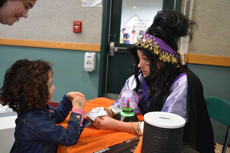 by: SUBMITTED - Hubbard resident and parent Christi Christenson poses as a fortune teller at the fourth annual carnival at North Marion Primary School on Saturday. The event allowed students and parents to participate in multiple activities while allowing other community groups to volunteer.