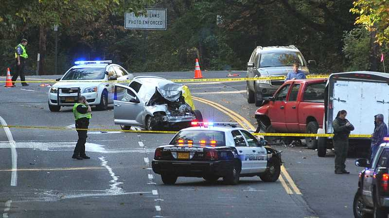 by: REVIEW PHOTO: VERN UYETAKE - A deadly two-car crash closed Highway 43 between Lake Oswego and the Sellwood Bridge Tuesday afternoon.