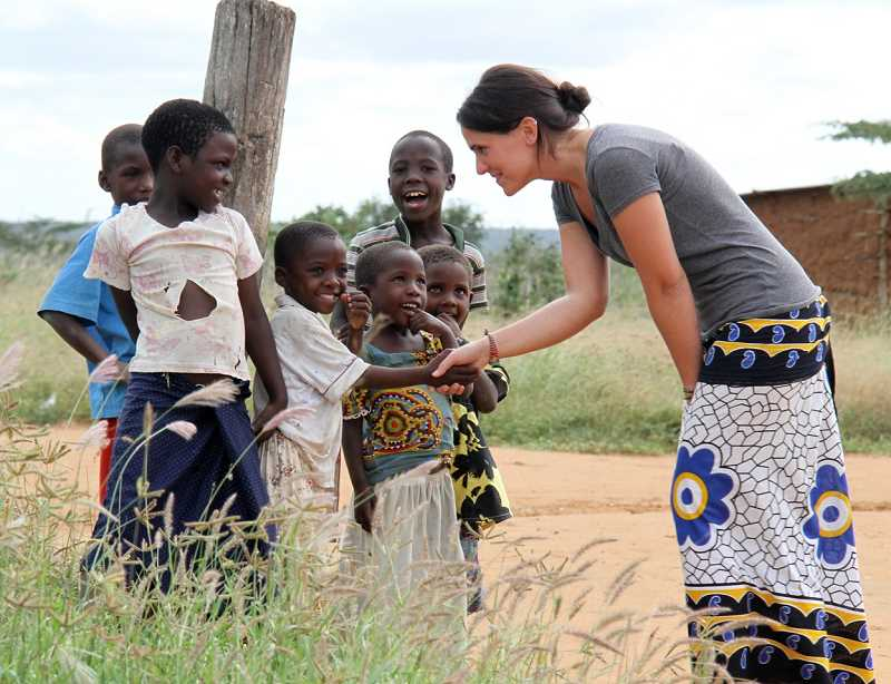 by: SUBMITTED - Aliska Julian, former Lake Oswego resident, makes friends with some shy but happy children in Kenya while on a mission trip for Kenya Keys.