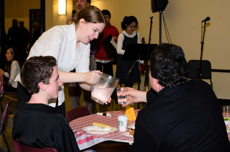 by: SUBMITTED FILE PHOTO - Sara Schultz serves guests at the 2012 fundraiser. She also plays saxophone in the WLHS band.