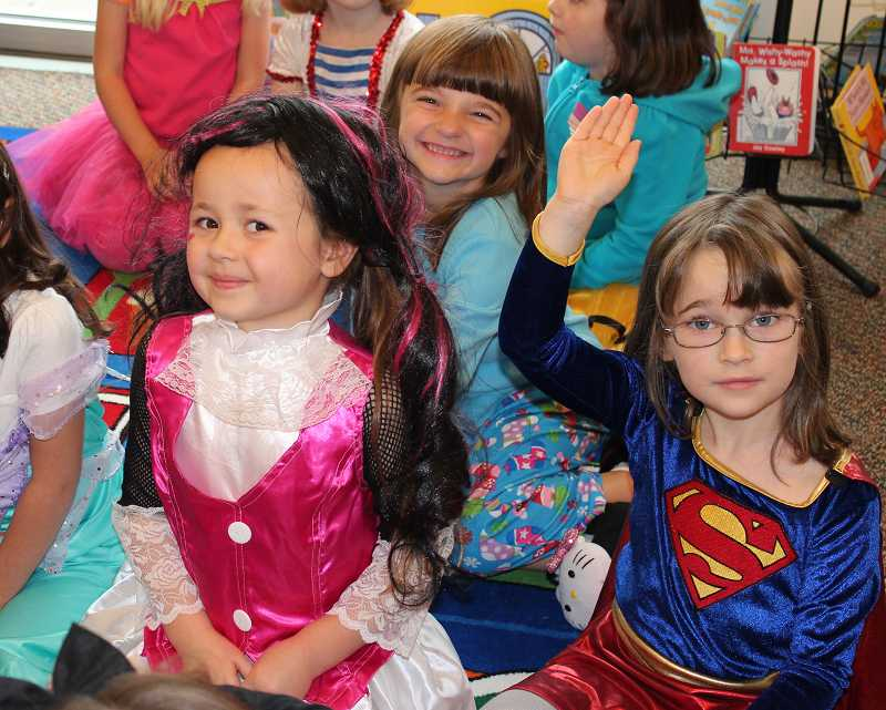 by: SUBMITTED PHOTO - From left, Lizzie Rice, Mia DePetris and Cynthia Yoder dress up for their kindergarten Halloween party in 2012.