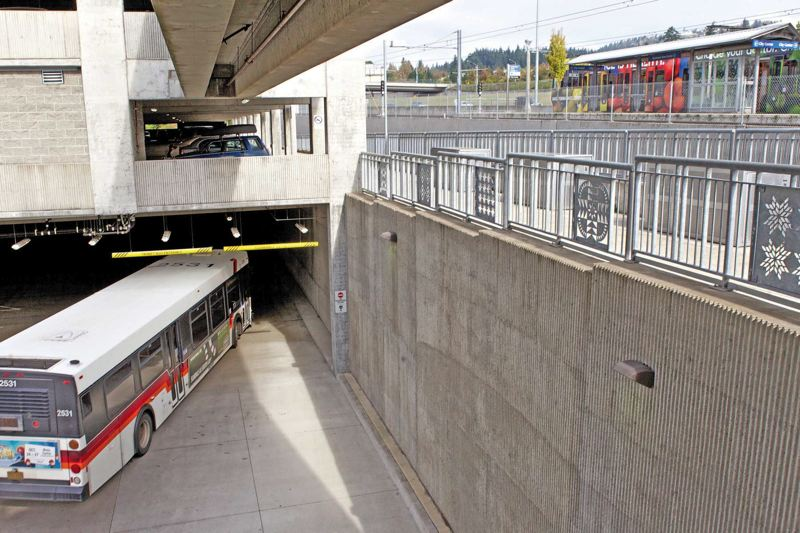 by: TRIBUNE PHOTO: JAIME VALDEZ - The Clackamas Town Center Transit Center conveniently connects cars, TriMet buses and MAX trains for commuters and shoppers.