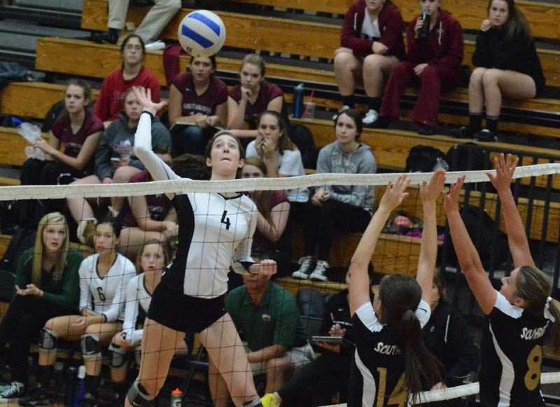 by: TIMES PHOTO: MATT SINGLEDECKER - Jesuit outside hitter Jasmine Gross goes up high above the net for a kill in the fourth set of the Crusaders win over Southridge on Tuesday.