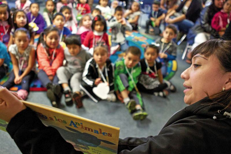 by: TRIBUNE PHOTO: JAIME VALDEZ - Vanessa Bojorquez reads to children at Latino Networks Juntos Aprendemos program at Glenfair Elementary School. The program is supported by a grant from the Oregon Community Foundation, which received its own surprise $170 million gift through a bequest at the end of 2011.