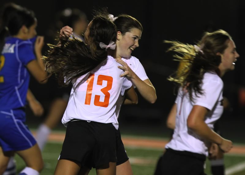by: TIMES PHOTO: JONATHAN HOUSE - Beavertons Robyn Schmutzer celebrates a goal over Aloha.