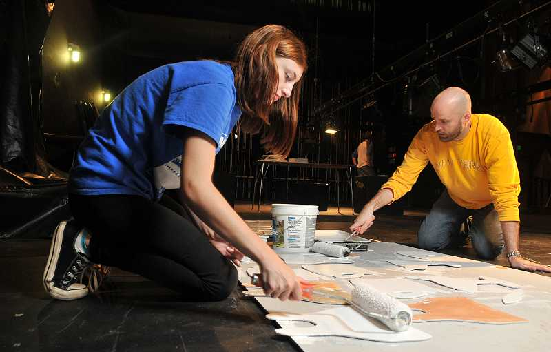by: REVIEW PHOTO: VERN UYETAKE - 'How to Succeed' stage manager Teia Jensen, left, and Andy Ballnik, Lakeridge drama director, are among a massive crew working on the schools musical productions.