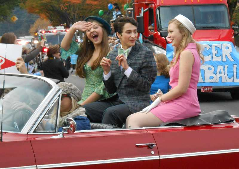 by: REVIEW PHOTO: JILLIAN DALEY - 'How to Succeed' actors rode in the Lakeridge High parade last week, including, from left: Abby Zink (Hedy LaRue), Lucas Friedman (J. Pierpont Finch) and Caroline Haroldson (Rosemary Pilkington).