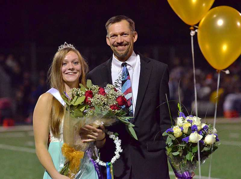 by: REVIEW PHOTO: VERN UYETAKE - Lakeridge senior Bailey Morris is honored as the homecoming queen with her father, Scott Morris, at her side.