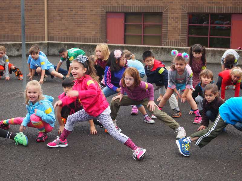 by: SUBMITTED PHOTO: LARAE BURKE - Hallinan teacher Ann Coles kindergarten class works out the kinks before the jog-a-thon, held Oct. 9, the same day as the schools walk or bike day.