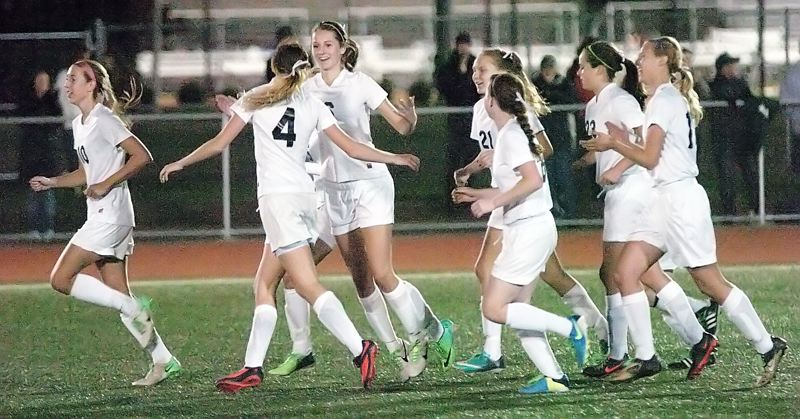 by: DAN BROOD - TIGER CELEBRATION -- The Tigard High School girls soccer team celebrates following senior Emilee Cincotta's tying goal in the opening minutes of the second half of Monday's match with Tualatin.