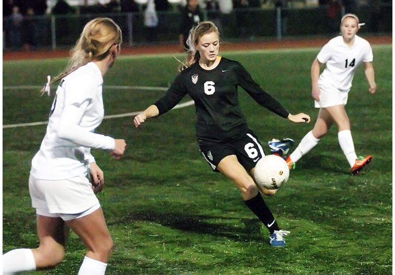 by: DAN BROOD - BOOT IT -- Tualatin senior Madison Campbell is about to send the ball flying during Monday's match at Tigard.