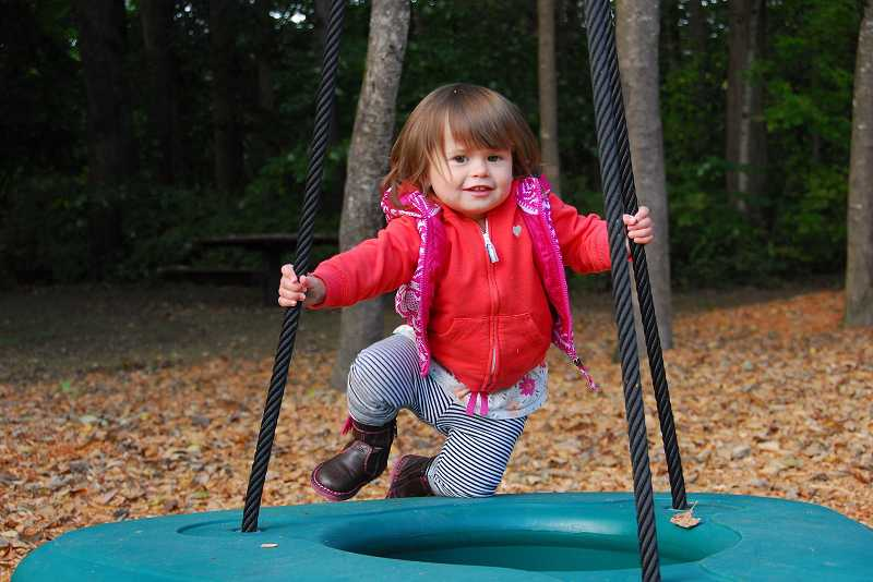 by: SUBMITTED PHOTOS - Julia Slythe enjoys the new play equipment in the Schlottmann Creek Greenway.
