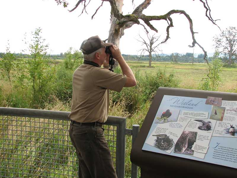 by: GAZETTE FILE PHOTO - Ralph Webber searches for wildlife at the Tualatin River National Wildlife Refuge in this 2010 photo. The refuge is included in the federal government's shutdown of many agencies.