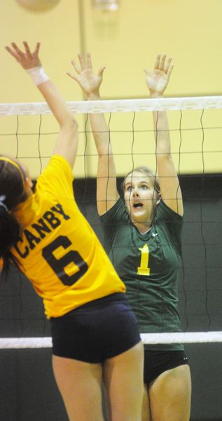 by: MATTHEW SHERMAN - West Linn's Hannah Rucker goes up for a block in Tuesday's three-set victory over Canby.