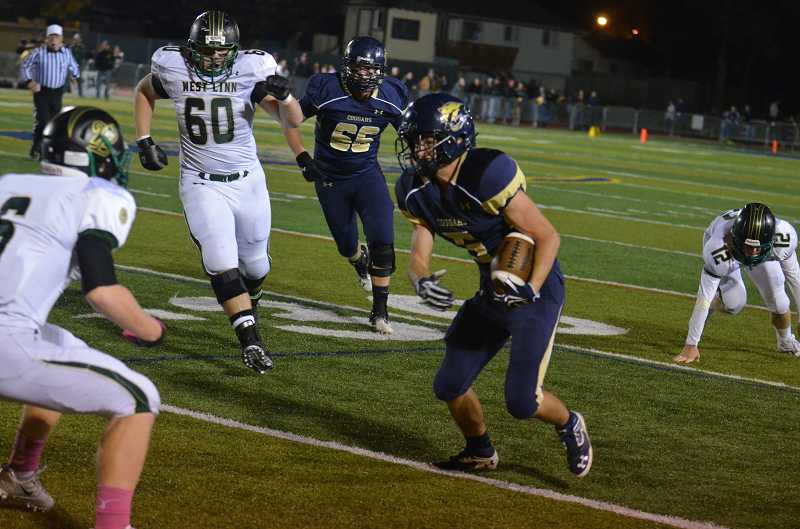 by: JEFF GOODMAN - Noah Kyllo took 44 carries for an unofficial 363 yards and two touchdowns as the Canby football team handled West Linn 35-14 at home Oct. 18.